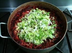 Adding napa cabbage last to simmering beets and leeks. I subbed potatoes for parsnips. (my photo).
